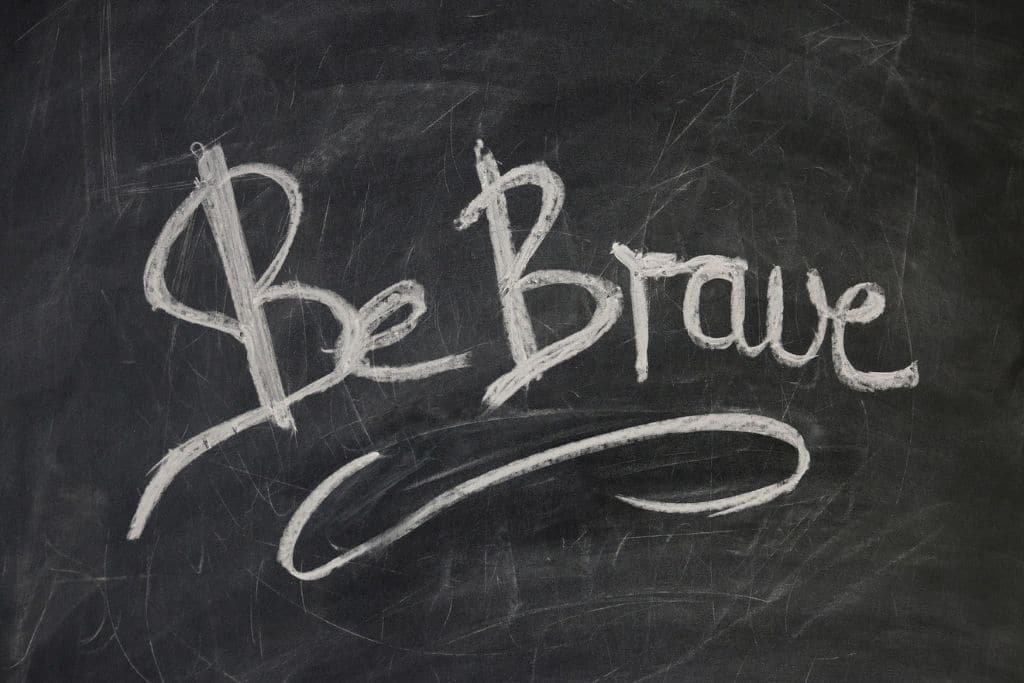 the words 'be brave' on blackboard