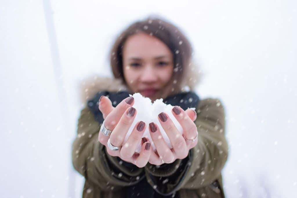 girl holding snowball