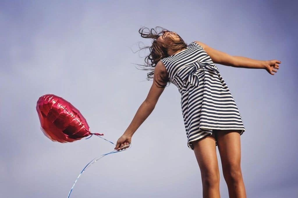 happy lady with balloon