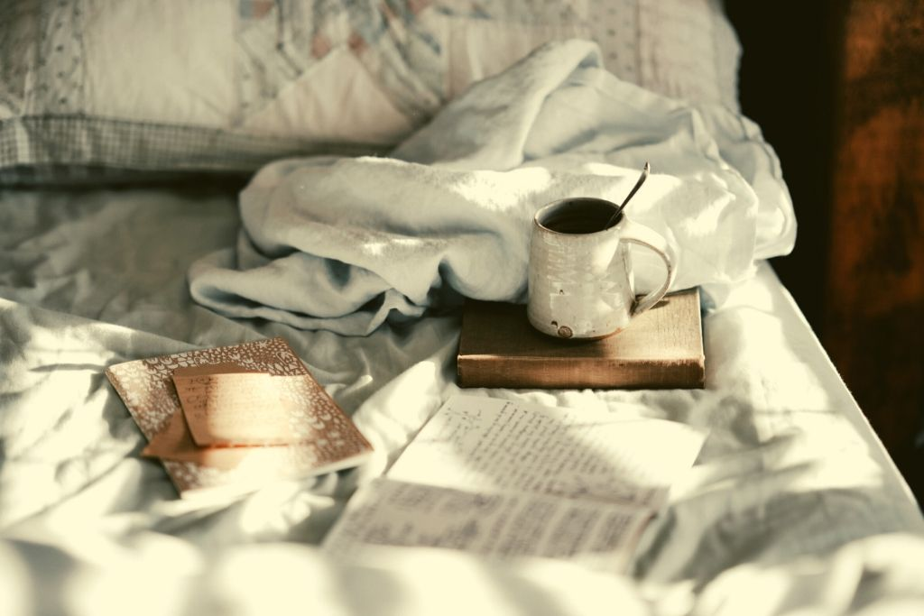 cosy bed with mug and book